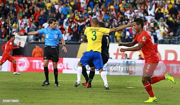 Peru's Andy Polo who set up the goal celebrates as Brazil goal keeper Alisson and teammate Miranda argue with an official that the goal scored by...