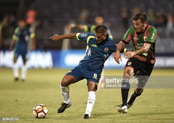 Peru's Cajamarca Gonzalo Baglivo vies for the ball with Uruguay's Rampla Matias Soto during their Copa Sudamericana football match at the Luis...