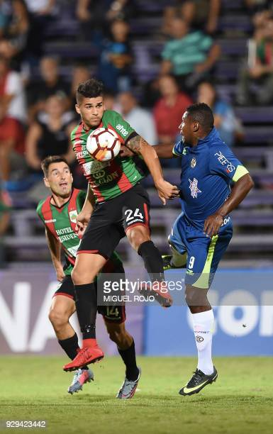 Peru's Cajamarca Jefferson Collazos vies for the ball with Uruguay's Rampla Gonzalo Rizzo during their Copa Sudamericana football match at the Luis...