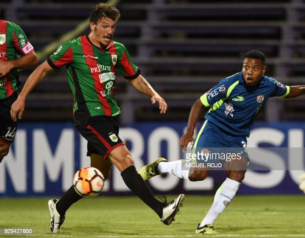 Peru's Cajamarca Jorge Bazan vies for the ball with Uruguay's Rampla Gonzalo Rizzo during their Copa Sudamericana football match at the Luis Franzini...