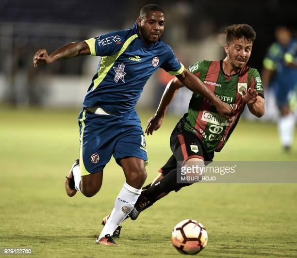 Peru's Cajamarca Roberto Guizasola vies for the ball with Uruguay's Rampla Igor Paim during their Copa Sudamericana football match at the Luis...