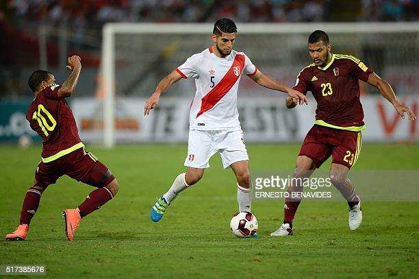 Peru's Carlos Zambrano is marked by Venezuela's Romulo Otero and Salomon Rondon during their Russia 2018 FIFA World Cup South American Qualifiers'...