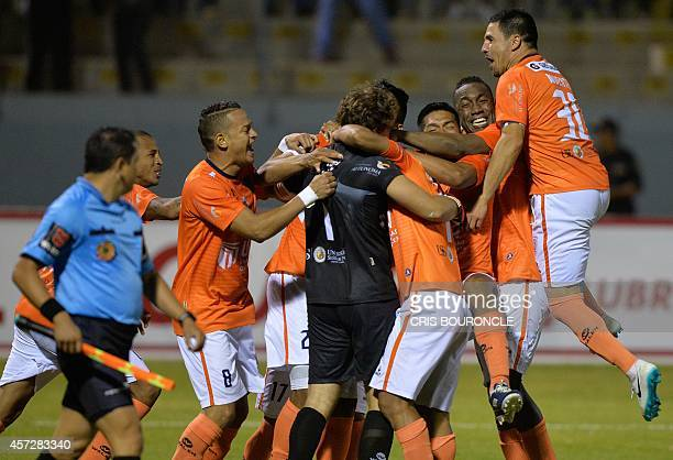 Perus Cesar Vallejo players celebrate the goal by goalkeeper Salomon Lipman which allows them to pass to quarter finals closing a set of kick shots...
