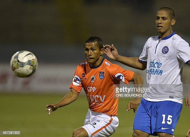 Perus Cesar Vallejo William Chiroque vies for the ball against Brazils Esporte Clube Bahia footballer Uelliton during their Copa Sudamericana...