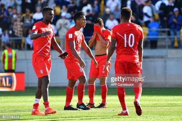 Peru's Christain Ramos Renato Tapia Paolo Hurtado and Jefferson Farfan react after a draw during the World Cup football qualifying match between New...