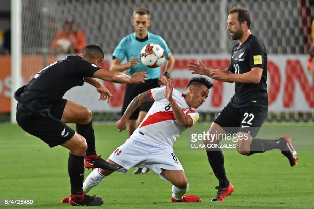 Peru's Christian Cueva vies for the ball with New Zealand's Andrew Durante and Winston Reid during their 2018 World Cup qualifying playoff second leg...