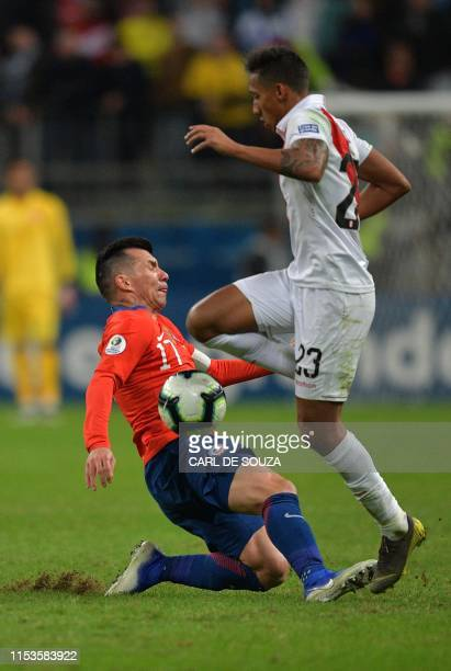 Peru's Christofer Gonzales vies for the ball with Chile's Gary Medel during their Copa America football tournament semifinal match at the Gremio...