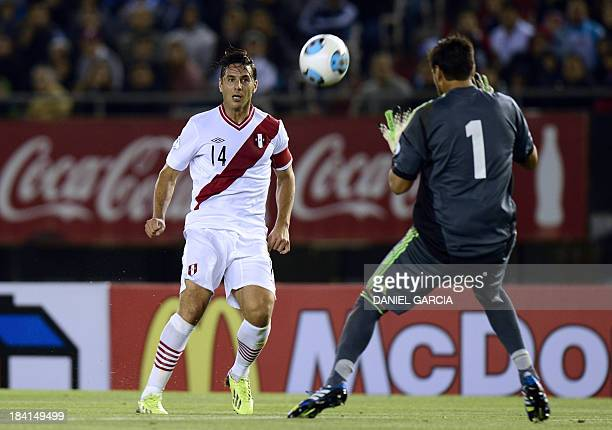 Peru's Claudio Pizarro scores over Argentina's goalkeeper Sergio Romero during their FIFA World Cup Brazil 2014 qualifier match at Monumental stadium...