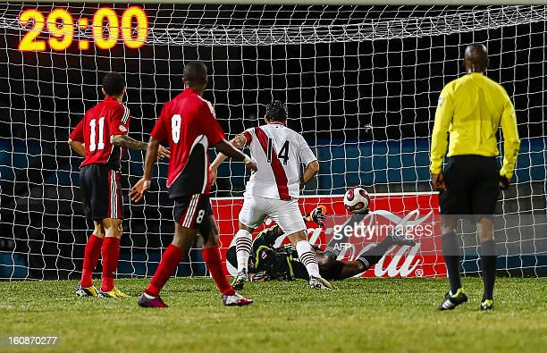 Peru's Claudio Pizarro scores the first goal of the match against Trinidad Tobago during their friendly match at Ato Bolton stadium in Couva Trinidad...