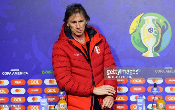 Peru's coach Ricardo Gareca arrives for a press conference in Porto Alegre Brazil on July 2 on the eve of their Copa America semifinal match against...