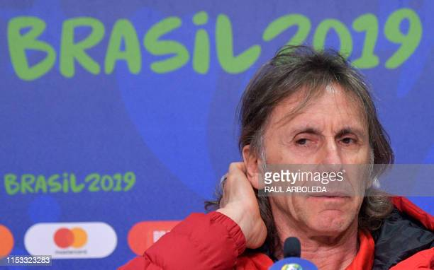 Peru's coach Ricardo Gareca gestures during a press conference in Porto Alegre Brazil on July 2 on the eve of their Copa America semifinal match...