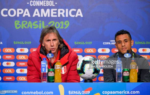 Peru's coach Ricardo Gareca snext to player Yoshimar Yotun during a press conference in Porto Alegre Brazil on July 2 on the eve of their Copa...
