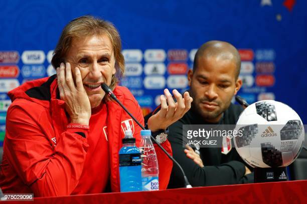 Peru's coach Ricardo Gareca speaks beside defender Alberto Rodriguez at a press conference at the Mordovia Arena in Saransk on June 15 a day ahead of...