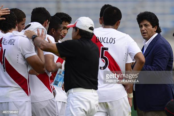 Peru's coach Victor Rivera gives instructions to his footballers during the South American U20 football match against Argentina at the Centenario...