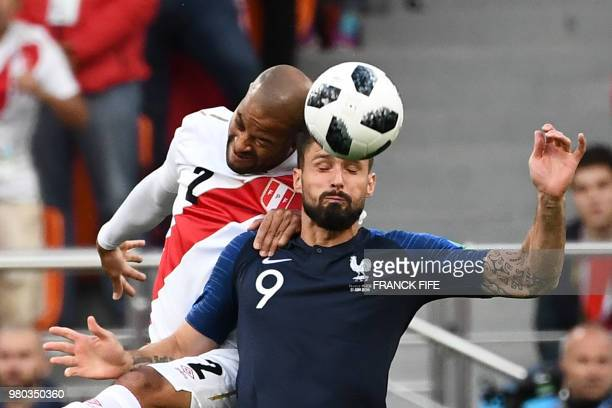 Peru's defender Alberto Rodriguez heads the ball as he vies for it with France's forward Olivier Giroud during the Russia 2018 World Cup Group C...