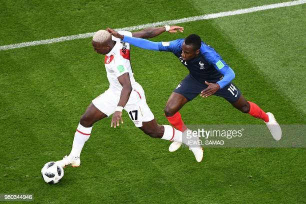 Peru's defender Luis Advincula and France's midfielder Blaise Matuidi compete for the ball during the Russia 2018 World Cup Group C football match...