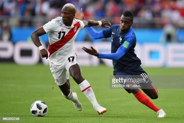 TOPSHOT Peru's defender Luis Advincula and France's midfielder Blaise Matuidi compete for the ball during the Russia 2018 World Cup Group C football...