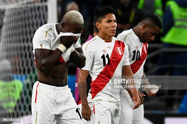 Peru's defender Luis Advincula and his teammates forward Raul Ruidiaz and forward Jefferson Farfan react after the final whistle of the Russia 2018...