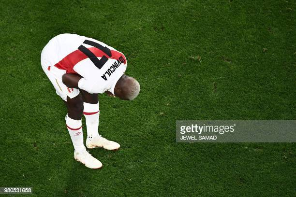 Peru's defender Luis Advincula reacts after defeat during the Russia 2018 World Cup Group C football match between France and Peru at the...
