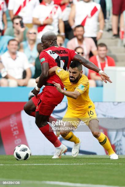 Peru's defender Luis Advincula vies for the ball with Australia's defender Aziz Behich during the Russia 2018 World Cup Group C football match...