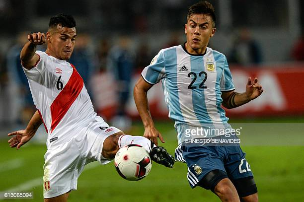 Peru's defender Miguel Trauco is marked by Argentina's Paulo Dybala during their Russia 2018 World Cup football qualifier match in Lima on October 6...