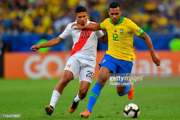 Peru's Edison Flores and Brazil's Alex Sandro vie for the ball during their Copa America football tournament final match at Maracana Stadium in Rio...