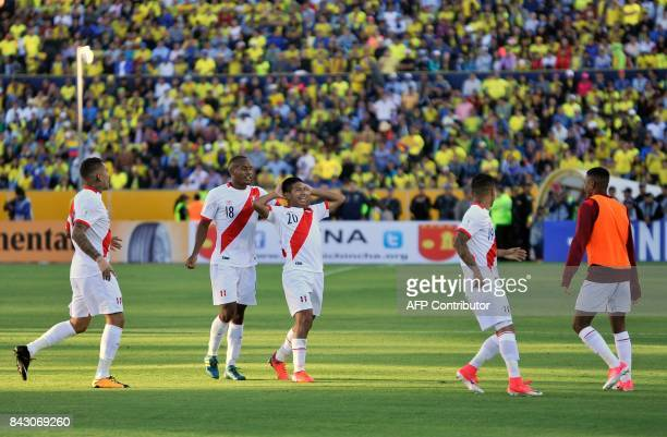 Peru's Edison Flores celebrates with teammates after scoring against Ecuador during their 2018 World Cup qualifier football match in Quito on...