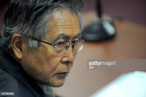Peru's expresident Alberto Fujimori is seen in a courtroom in Lima on September 30 before hearing the sentence on his fourth trial in this case for...