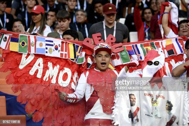 A Peru's fan cheers during the Russia 2018 World Cup Group C football match between Peru and Denmark at the Mordovia Arena in Saransk on June 16 2018...