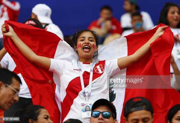 A Peru's fan cheers prior to the Russia 2018 World Cup Group C football match between Peru and Denmark at the Mordovia Arena in Saransk on June 16...