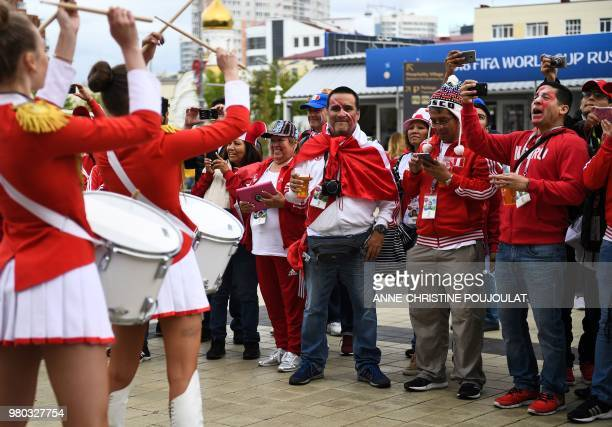 Peru's fans listen to a group of majorettes playing the drum at the stadium's entrance prior to the Russia 2018 World Cup Group C football match...