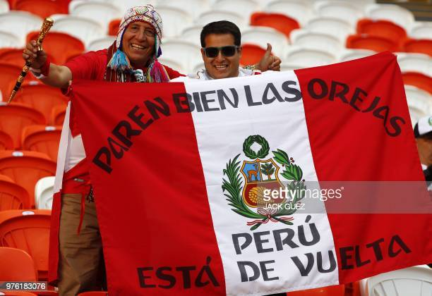 Peru's fans wave a Peruvian national flag as they cheer prior to the Russia 2018 World Cup Group C football match between Peru and Denmark at the...