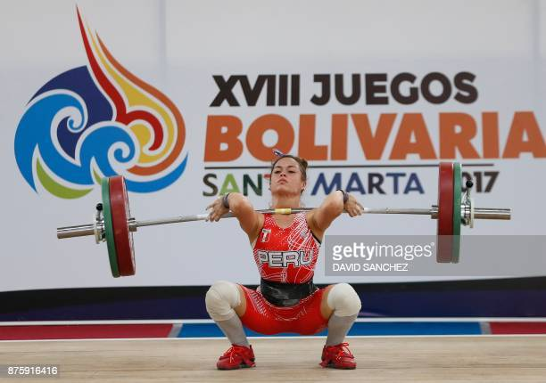 Peru's Fiorella Cueva competes in the women's 48kg snatch during the XVIII Bolivarian Games in Santa Marta Colombia on November 18 2017 / AFP PHOTO /...