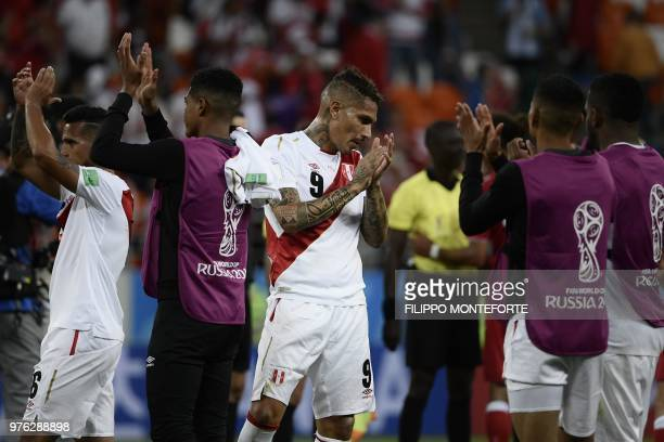 Peru's football players applaud and react at the end of the Russia 2018 World Cup Group C football match between Peru and Denmark at the Mordovia...