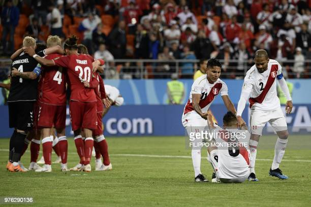 Peru's football players react at the end of the Russia 2018 World Cup Group C football match between Peru and Denmark at the Mordovia Arena in...