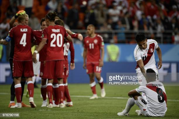 TOPSHOT Peru's football players react at the end of the Russia 2018 World Cup Group C football match between Peru and Denmark at the Mordovia Arena...