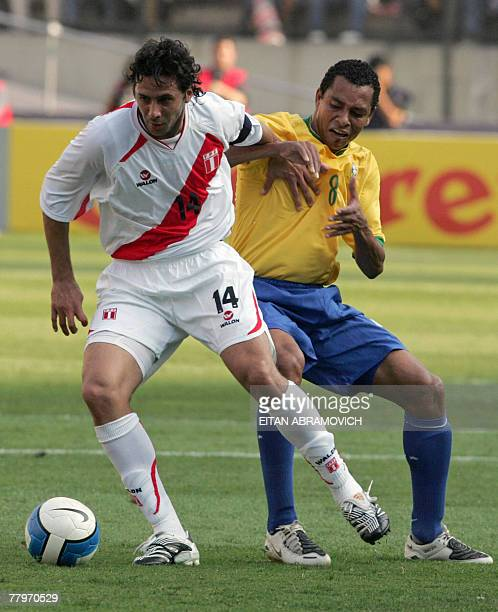 Peru's footballer Claudio Pizarro vies for the ball with Gilberto Silva of Brazil during their South American qualifying round match of the FIFA...
