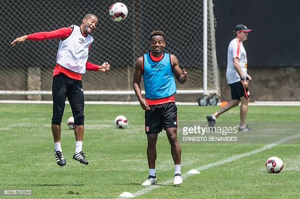 Peru's footballers Alberto Rodriguez and Andre Carillo take part in a training session in Lima on November 12 ahead of their WC 2018 qualifier match...