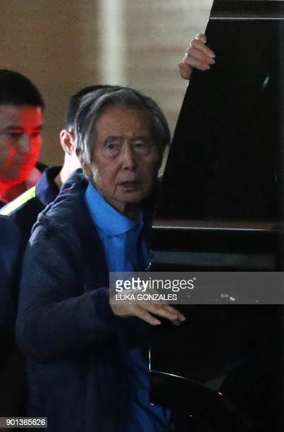 Peru's former President Alberto Fujimori boards a car after he was wheeled out of the Centenario Clinic in Lima on January 04 where he was...