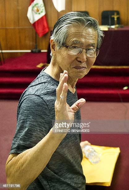 Peru's former President Alberto Fujimori gestures just before the reading of the verdict on charges of embezzling state funds and using them to...