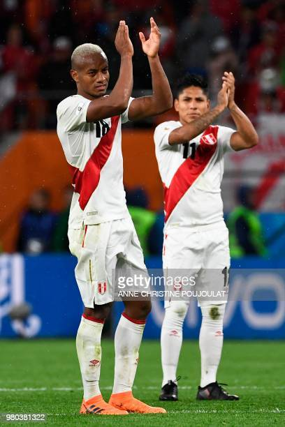 Peru's forward Andre Carrillo and Peru's forward Raul Ruidiaz applaud after the final whistle of the Russia 2018 World Cup Group C football match...