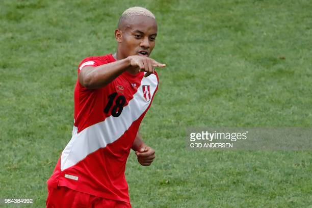 Peru's forward Andre Carrillo celebrates after scoring the opening goal during the Russia 2018 World Cup Group C football match between Australia and...