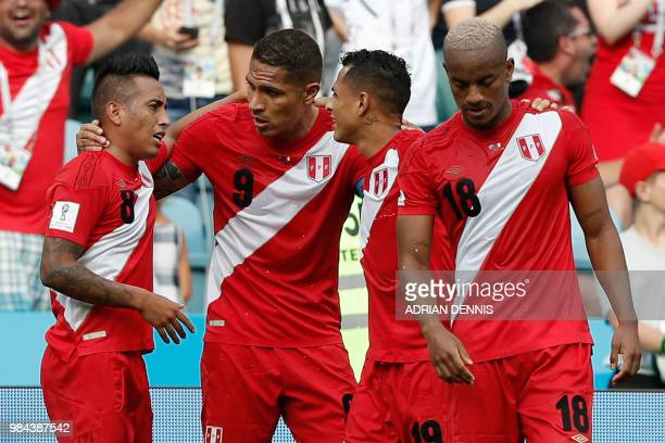 Peru's forward Andre Carrillo celebrates with teammates after scoring the opening goal during the Russia 2018 World Cup Group C football match...