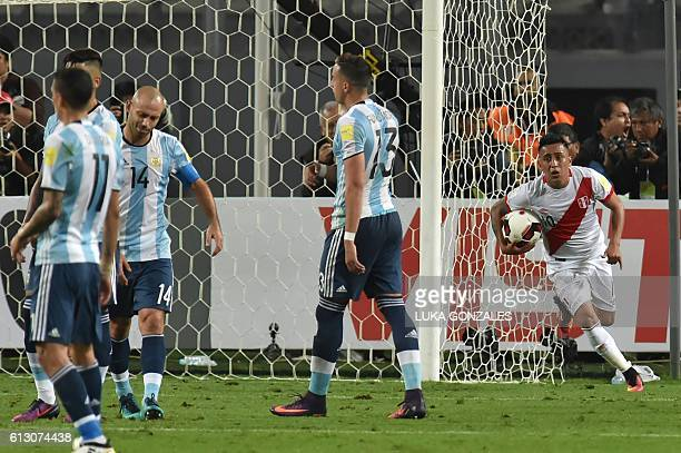 Peru's forward Christian Cueva celebrates after scoring a penalty against Argentina during their Russia 2018 World Cup football qualifier match in...