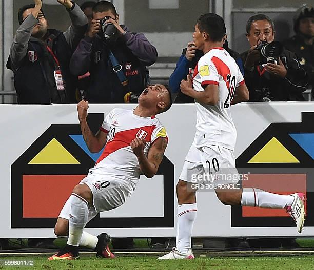 Peru's forward Christian Cueva celebrates after scoring against Ecuador during their Russia 2018 FIFA World Cup qualifier football match between Peru...