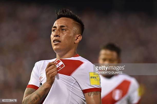 Peru's forward Christian Cueva celebrates after scoring the team's third goal against Paraguay during their FIFA 2018 World Cup qualifier football...