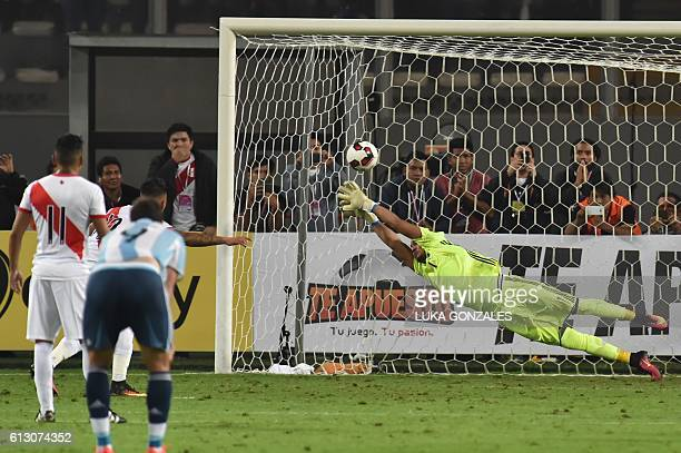 Peru's forward Christian Cueva scores a penalty past Argentina's goalkeeper Sergio Romero during their Russia 2018 World Cup football qualifier match...
