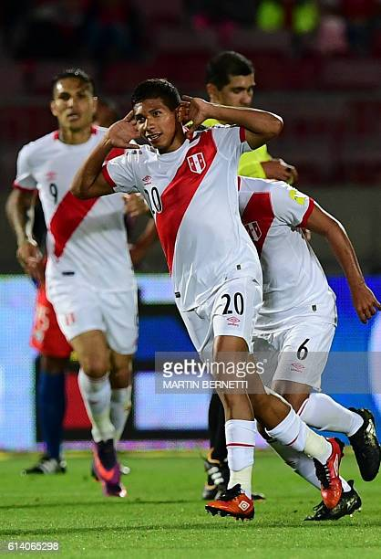 Peru's forward Edison Flores celebrates after scoring against Argentina during their Russia 2018 World Cup qualifier football match in Santiago on...