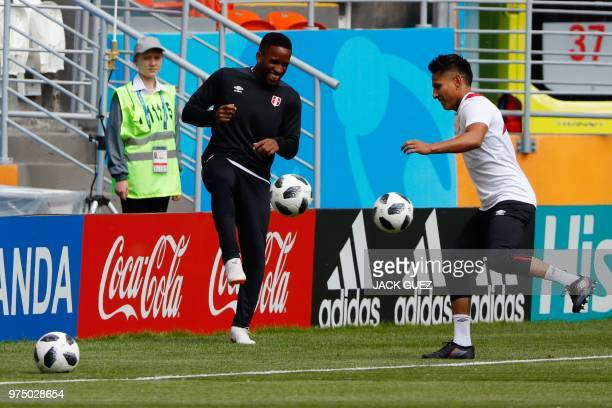 Peru's forward Jefferson Farfan and forward Raul Ruidiaz take part in a training session at the Mordovia Arena in Saransk on June 15 a day ahead of...
