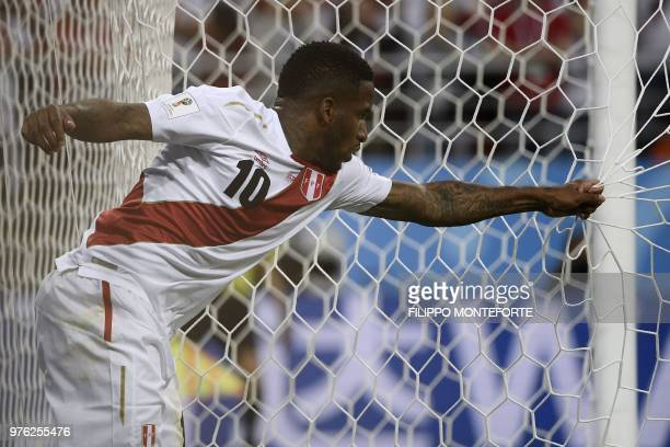 TOPSHOT Peru's forward Jefferson Farfan reacts as he pulls the goal's net during the Russia 2018 World Cup Group C football match between Peru and...